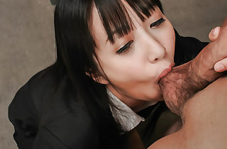 Pretty chick on her knees performing a spicy fellatio