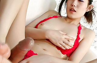 Pretty babe Yui Komine uses a sex toy to have fun with her nipples and round orbs as her man witnesses